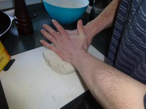 My hubby kneading the home-made dough