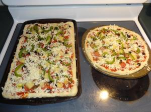 Second layer of toppings (green peppers, mushrooms, more mozzarella cheese)