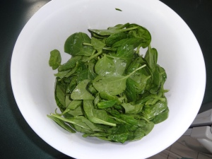 Baby spinach drizzled with sesame oil, garlic powder and a pinch of salt