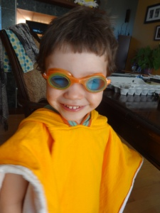 Caleb with his 'super-hero' goggles, ready for his swimming pool adventure!