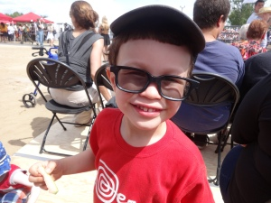 Caleb sporting his funky sunglasses and waiting for the horses to arrive!