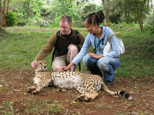 One of those 'joyful' moments. My husband and I petting a cheetah in Kenya.