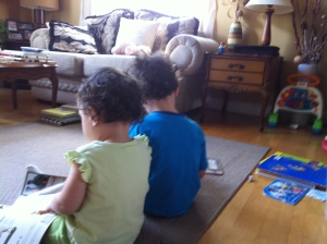 Caleb the bookworm being a good example for his little sister! When not fighting over toys, they love reading together!