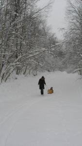 Pulling my son Caleb along a snowy road in the winter of 2013 (Sainte Agathe-des-Monts, Québec)